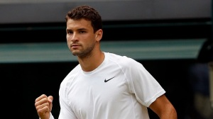 Bulgaria's Grigor Dimitrov celebrates a point against Australia's Luke Saville during day three of the Wimbledon Championships at the All England Lawn Tennis and Croquet Club, Wimbledon.