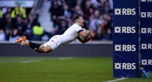 England's Danny Care dives in to score a try during the RBS 6 Nations match at Twickenham Stadium, London. PRESS ASSOCIATION Photo. Picture date: Saturday February 22, 2014. See PA story RUGBYU England. Photo credit should read: Andrew Matthews/PA Wire. RESTRICTIONS: Editorial use only. No commercial use. No video emulation. Photographs cannot be altered or adjusted other than in the course of normal journalistic or editorial practice. Call +44 (0)1158 447447 for further information.